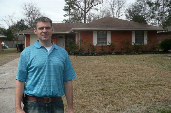 Titan Home Buyers owner standing in front of a house