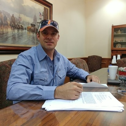 Titan Home Buyers owner signing documents